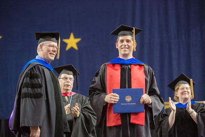 Dominick Lemas was one of a record number of PhD recipients in the class of 2013, earning his doctoral degree in biochemisty and molecular biology.  Filename: GRA-13-3827-0731.jpg