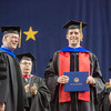 """Dominick Lemas was one of a record number of PhD recipients in the class of 2013, earning his doctoral degree in biochemisty and molecular biology.  <div class=""""ss-paypal-button"""">Filename: GRA-13-3827-0731.jpg</div><div class=""""ss-paypal-button-end"""" style=""""""""></div>"""