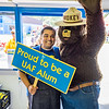 "UAF Alumni Association board member Mike Campbell enjoys a visit from another celebrity during his shift in the Alumni Burger Booth at the 2015 Tanana Valley State Fair.  <div class=""ss-paypal-button"">Filename: DEV-15-4596-035.jpg</div><div class=""ss-paypal-button-end""></div>"