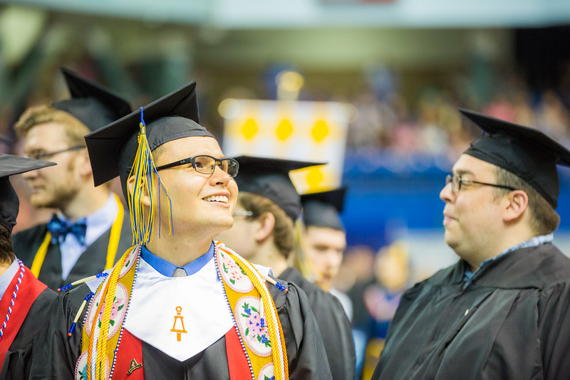 """Engineering graduate Raymond Kangas looks to the audience during the Commencement 2016 processional at the Carlson Center.  <div class=""""ss-paypal-button"""">Filename: GRA-16-4896-340.jpg</div><div class=""""ss-paypal-button-end""""></div>"""