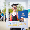 """Graduates pose for a photo after the 2016 commencement ceremony outside the Carlson Center.  <div class=""""ss-paypal-button"""">Filename: GRA-16-4895-271.jpg</div><div class=""""ss-paypal-button-end""""></div>"""
