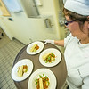"""Rose Estrada carries a tray of manicotti being served to guests at the annual CTC culinary scholarship banquet in the Hutchison Institute of Technology.  <div class=""""ss-paypal-button"""">Filename: DEV-12-3383-209.jpg</div><div class=""""ss-paypal-button-end"""" style=""""""""></div>"""