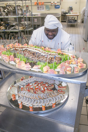 Stephen Beazer loads a cart with trays of appetizers from the cooler before the 2012 CTC Culinary Arts scholarship banquet at the Hutchison Institute of Technology.  Filename: DEV-12-3383-009.jpg