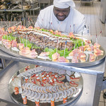 Stephen Beazer loads a cart with trays of appetizers from the cooler before the 2012 CTC Culinary Arts scholarship banquet at the Hutchison Institute of Technology.