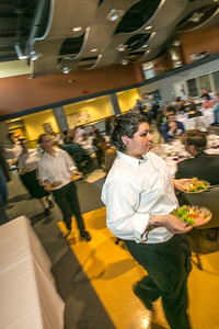 Charlotte Gordon serves plates of salad to guests attending the annual CTC culinary scholarship banquet in the Hutchison Institute of Technology.  Filename: DEV-12-3383-146.jpg