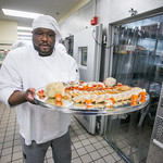 Stephen Beazer carries a tray of appetizers from the cooler before the 2012 CTC Culinary Arts scholarship banquet at the Hutchison Institute of Technology.