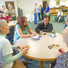 """Mary Albanese, second from left, visits with staff and patrons of the Rasmuson Library during a reception in her honor. Mary and her husband Tom, both alumni of UAF, recently donated a collection of original paintings by Sydney Lawrene to the library.  <div class=""""ss-paypal-button"""">Filename: DEV-14-4202-19.jpg</div><div class=""""ss-paypal-button-end""""></div>"""