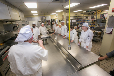 Students line up to hear instructions before the start of the CTC Culinary Arts scholarship banquet at the Hutchison Institute of Technology.  Filename: DEV-12-3383-063.jpg