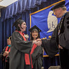 """Graduates receive congratulatory handshakes from UAF officials during the  Bristol Bay campus 2012 commencement ceremony in Dillingham.  <div class=""""ss-paypal-button"""">Filename: GRA-12-3391-352.jpg</div><div class=""""ss-paypal-button-end"""" style=""""""""></div>"""