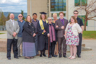 2014 graduate Mamie Davis poses with her family after the honors program commencement ceremony May 10 on the Fairbanks campus.  Filename: GRA-14-4183-244.jpg