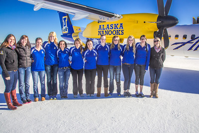 Members of the UAF volleyball team pose by one of the newest planes in the Alaska Airlines fleet, a Bombardier Q400 turboprop, which features the Alaska Nanooks and UAF.  Filename: DEV-14-4080-94.jpg