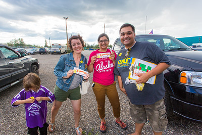 UAF alums Brenda Riley, left, Charu Uppal and Mike Campbell get ready to enjoy the annual UAF Alumni Night with the Alaska Goldpanners at Growden Field on July 22.  Filename: DEV-15-4583-15.jpg
