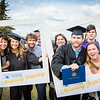 "Graduates surrounded by friends and family pose for a photo after the 2016 commencement ceremony outside the Carlson Center.  <div class=""ss-paypal-button"">Filename: GRA-16-4895-176.jpg</div><div class=""ss-paypal-button-end""></div>"