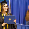 """UAF journalism graduate Elena Sudduth pauses for a photo with her diploma cover during the 2015 commencement ceremony at the Carlson Center.  <div class=""""ss-paypal-button"""">Filename: GRA-15-4539-455.jpg</div><div class=""""ss-paypal-button-end""""></div>"""