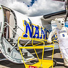"The Nanook mascot stands by the Era Alaska newly painted Bombardier Dash-8 which features the Alaska Nanooks colors and logo on one side, and a UAA Seawolves treatment on the other.  <div class=""ss-paypal-button"">Filename: DEV-13-3858-73.jpg</div><div class=""ss-paypal-button-end"" style=""""></div>"