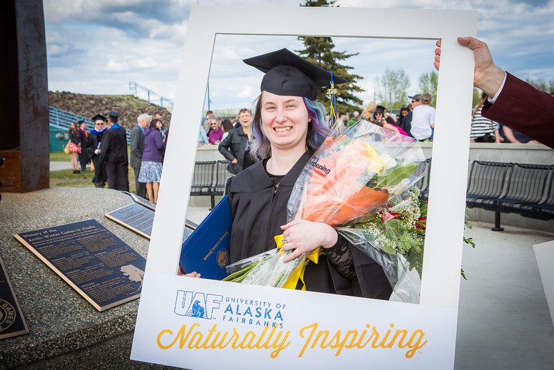 """Graduates pose for a photo after the 2016 commencement ceremony outside the Carlson Center.  <div class=""""ss-paypal-button"""">Filename: GRA-16-4895-218.jpg</div><div class=""""ss-paypal-button-end""""></div>"""
