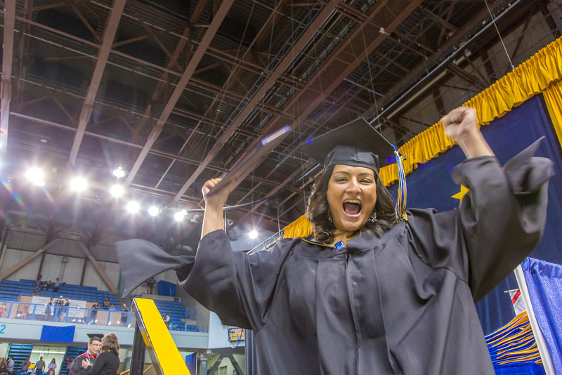 """Charu Uppal is pretty happy after accepting her master of business administration degree during UAF's commencement ceremony May 11 in the Carlson Center.  <div class=""""ss-paypal-button"""">Filename: GRA-14-4186-0872.jpg</div><div class=""""ss-paypal-button-end"""" style=""""""""></div>"""