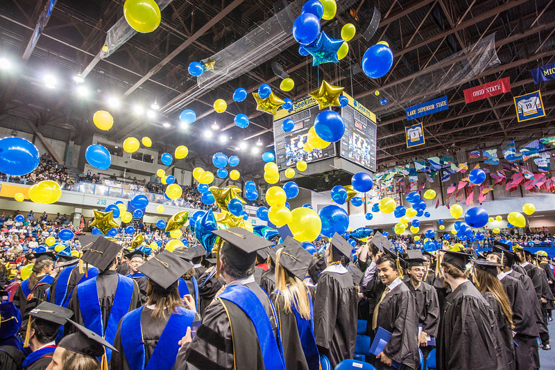 """Members of UAF's class of 2013 react to the traditional balloon drop at the conclusion of the ceremony.  <div class=""""ss-paypal-button"""">Filename: GRA-13-3827-1003.jpg</div><div class=""""ss-paypal-button-end"""" style=""""""""></div>"""