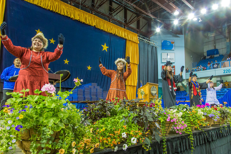 """The Inu-Yupiaq dance group led the traditional processional and performed onstage during UAF's 2014 Commencement ceremony May 11 in the Carlson Center.  <div class=""""ss-paypal-button"""">Filename: GRA-14-4186-0168.jpg</div><div class=""""ss-paypal-button-end"""" style=""""""""></div>"""
