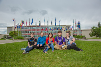 Students pose for a Development photo shoot in front of the Circle of Flags in Cornerstone Plaza. Left to right: Noah Betzen, Caltlin Kaber, Kaleidra Chavis, Adam McCombs, Angie Cocuzza.  Filename: DEV-12-3460-051.jpg