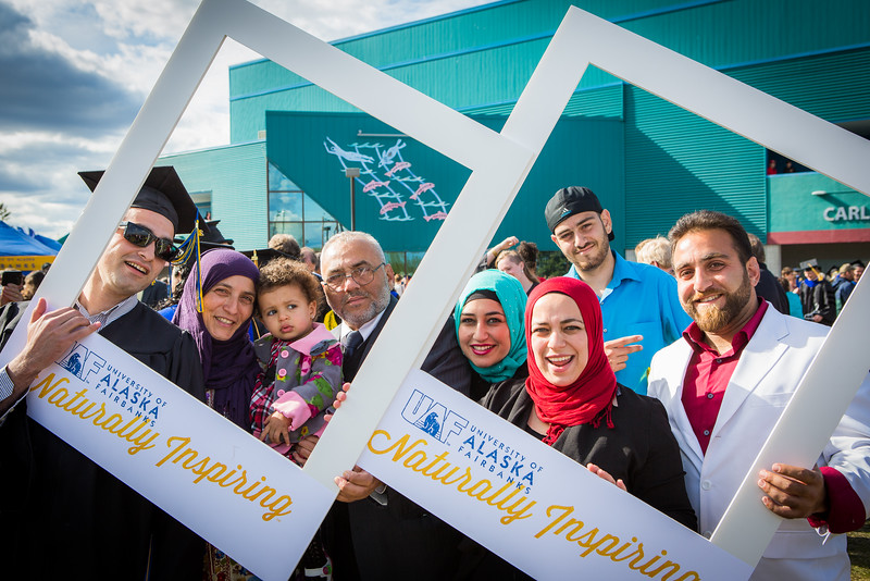 """Graduates surrounded by friends and family pose for a photo after the 2016 commencement ceremony outside the Carlson Center.  <div class=""""ss-paypal-button"""">Filename: GRA-16-4895-144.jpg</div><div class=""""ss-paypal-button-end""""></div>"""