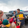 "UAF Alumni Association board member Mike Campbell and fellow alum Brenda Riley hand out buttons as fans of the Alaska Goldpanners arrive at Growden Field for the annual UAF Alumni Night on July 22.  <div class=""ss-paypal-button"">Filename: DEV-15-4583-1.jpg</div><div class=""ss-paypal-button-end""></div>"