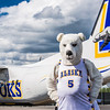 "The Nanook mascot stands by the Era Alaska newly painted Bombardier Dash-8 which features the Alaska Nanooks colors and logo on one side, and a UAA Seawolves treatment on the other.  <div class=""ss-paypal-button"">Filename: DEV-13-3858-102.jpg</div><div class=""ss-paypal-button-end"" style=""""></div>"