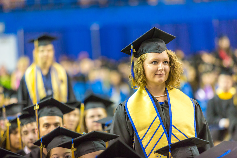 """Mamie Davis stands from her seat in the crowd as she's recognized for her leadership honors during UAF's commencement ceremony May 11 in the Carlson Center.  <div class=""""ss-paypal-button"""">Filename: GRA-14-4186-1031.jpg</div><div class=""""ss-paypal-button-end"""" style=""""""""></div>"""