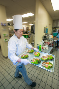 Yun Ji Hong carries a tray of salads being served to guests at the annual CTC culinary scholarship banquet in the Hutchison Institute of Technology.  Filename: DEV-12-3383-141.jpg