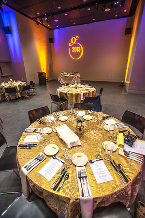 The logo designed for the Gold Dinner, an annual event for UAF honorary degree recipients and other commencement special guests, is projected on the wall at the auditorium in University of Alaska Museum of the North.  Filename: GRA-13-3826-7.jpg