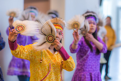 Members of a Dillingham high school Native dance ensemble perform during the 2012 Honorary Degree Recipients dinner during commencement weekend in the University of Alaska Museum of the North.  Filename: GRA-12-3409-132.jpg