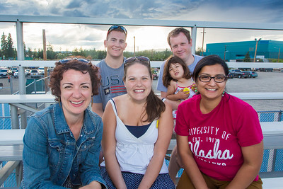 UAF alums cheer on the Alaska Goldpanners during the annual Alumni Night  at Growden Field on July 22. Pictured are back row left Gary Olsen-Saville, Ross Imbler with 3-year-old daughter Sitara. Front row left to right, Brenda Riley, Megan Olsen-Saville and Charu Uppal.  Filename: DEV-15-4583-49.jpg