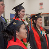 """Graduates in the class of 2012 from UAF's Bristol Bay Campus in Dillingham pose for photos in their caps and gowns before the commencement ceremony.  <div class=""""ss-paypal-button"""">Filename: GRA-12-3391-084.jpg</div><div class=""""ss-paypal-button-end"""" style=""""""""></div>"""