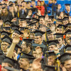 """Graduates raise their hands during an interactive speech delivered by student speaker Ashley Strauch during UAF's commencement ceremony May 11 in the Carlson Center.  <div class=""""ss-paypal-button"""">Filename: GRA-14-4186-1068.jpg</div><div class=""""ss-paypal-button-end"""" style=""""""""></div>"""