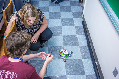Marisa Sharrah, public affairs officer with Flint Hills Resources, visits with students attending the Alaska Summer Research Academy (ASRA) in the Reichardt Building on the Fairbanks campus. Flint Hills has been a long time supporter of the program.  Filename: DEV-12-3473-106.jpg