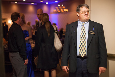 UAF Alumni Association President Jim Dixon greets guests at the 2012 Rendezvous Dinner September 22, 2012 at the Westmark ballroom.  Filename: DEV-12-3566-59.jpg