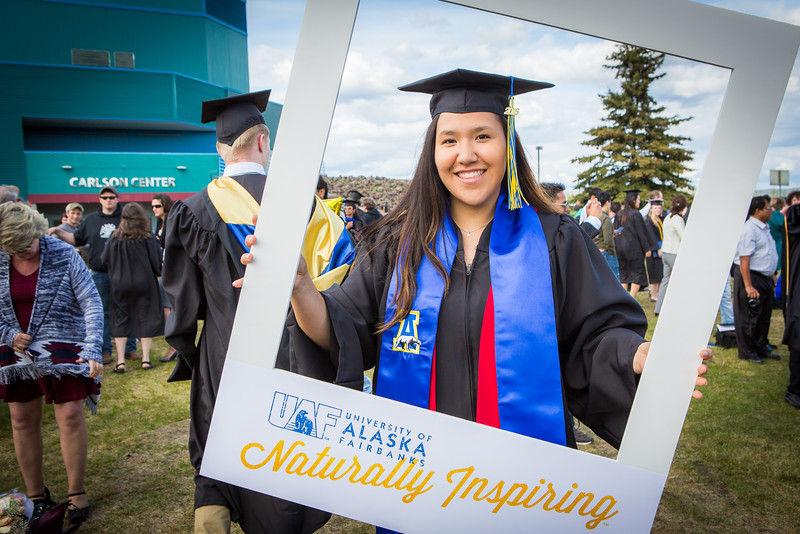 """Graduates pose for a photo after the 2016 commencement ceremony outside the Carlson Center.  <div class=""""ss-paypal-button"""">Filename: GRA-16-4895-195.jpg</div><div class=""""ss-paypal-button-end""""></div>"""