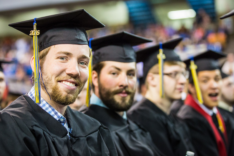 """Justin Schneider pauses for a photo during the 2016 commencement ceremony at the Carlson Center.  <div class=""""ss-paypal-button"""">Filename: GRA-16-4896-972.jpg</div><div class=""""ss-paypal-button-end""""></div>"""