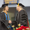 """Dean Mark Herrmann greats MBA graduate Inna Conner as she walks across the stage.  <div class=""""ss-paypal-button"""">Filename: GRA-13-3827-0589.jpg</div><div class=""""ss-paypal-button-end"""" style=""""""""></div>"""