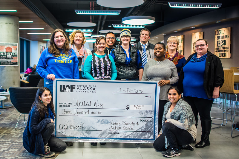 """Members of the Nanook Diversity and Action Center present a check to UAF United Way committee chairs after raising money at the annual Chili Cook-off held Nov. 30 in Wood Center.  <div class=""""ss-paypal-button"""">Filename: DEV-16-5080-6.jpg</div><div class=""""ss-paypal-button-end""""></div>"""