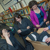 """Graduates in the class of 2012 from UAF's Bristol Bay Campus in Dillingham try on their caps and gowns in the comunity library before the commencement ceremony.  <div class=""""ss-paypal-button"""">Filename: GRA-12-3391-041.jpg</div><div class=""""ss-paypal-button-end"""" style=""""""""></div>"""