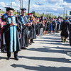 "Forming a line outside the Carlson Center, faculty greet and congratulate the students after the Commencement 2016 ceremony.  <div class=""ss-paypal-button"">Filename: GRA-16-4896-1118-2.jpg</div><div class=""ss-paypal-button-end""></div>"