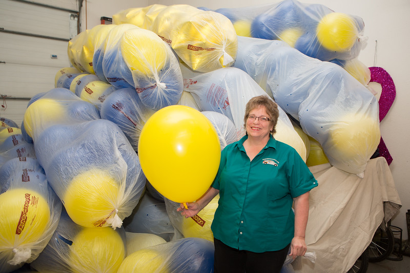 """For more than ten years, Beth Brummond has been filling balloons for the annual UAF commencement ceremony balloon drop.  <div class=""""ss-paypal-button"""">Filename: GRA-16-4889-52.jpg</div><div class=""""ss-paypal-button-end""""></div>"""