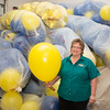 "For more than ten years, Beth Brummond has been filling balloons for the annual UAF commencement ceremony balloon drop.  <div class=""ss-paypal-button"">Filename: GRA-16-4889-52.jpg</div><div class=""ss-paypal-button-end""></div>"