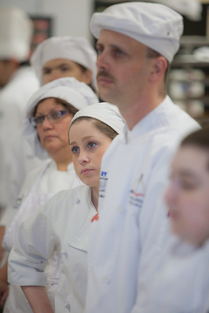 Students line up to hear instructions before the start of the CTC Culinary Arts scholarship banquet at the Hutchison Institute of Technology.  Filename: DEV-12-3383-058.jpg