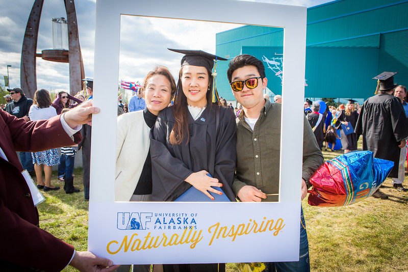 """Graduates surrounded by friends and family pose for a photo after the 2016 commencement ceremony outside the Carlson Center.  <div class=""""ss-paypal-button"""">Filename: GRA-16-4895-152.jpg</div><div class=""""ss-paypal-button-end""""></div>"""