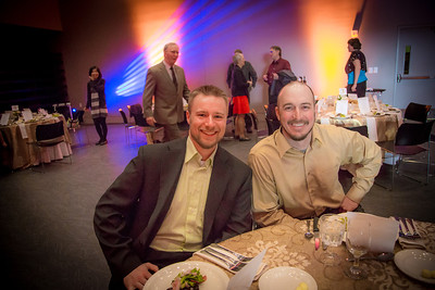 UAF alum and Olympic medalist Matt Emmons, left, poses with UAF rifle coach Dan Jordan during the annual Gold Dinner held at the University of Alaska's Museum of the North. Emmons was honored for his role as commencement speaker for the class of 2013.  Filename: GRA-13-3826-126.jpg