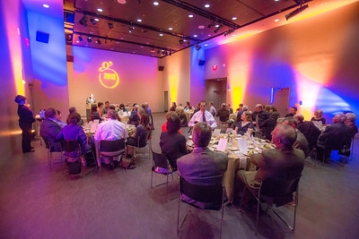 The logo designed for the Gold Dinner, an annual event for UAF honorary degree recipients and other commencement special guests, is projected on the wall at the auditorium in University of Alaska Museum of the North.  Filename: GRA-13-3826-133.jpg