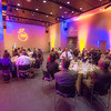 """The logo designed for the Gold Dinner, an annual event for UAF honorary degree recipients and other commencement special guests, is projected on the wall at the auditorium in University of Alaska Museum of the North.  <div class=""""ss-paypal-button"""">Filename: GRA-13-3826-133.jpg</div><div class=""""ss-paypal-button-end"""" style=""""""""></div>"""