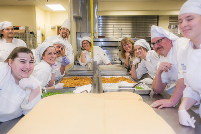 Students and staff pause for a group photo in the kitchen during the annual CTC culinary scholarship banquet in the Hutchison Institute of Technology.  Filename: DEV-12-3383-153.jpg